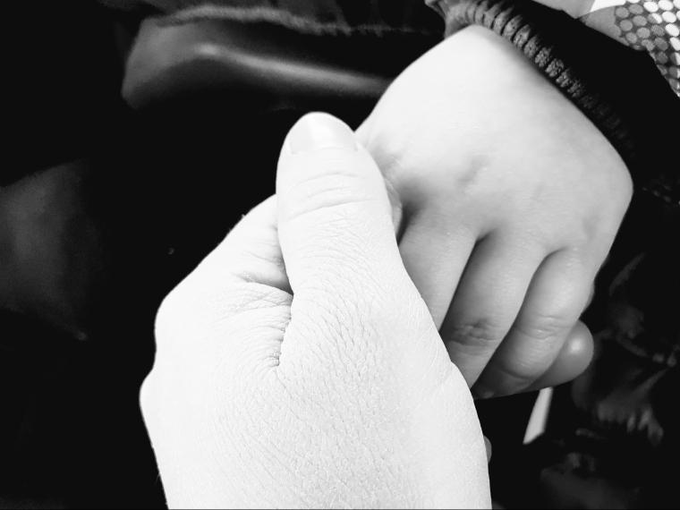 holding-hands-e1545596681195.jpg